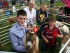 1st/2nd & 3rd Best Goatling winner Ethan Cranston (Castleblaney) with Conor Edwards and Reece Reeddan (Newtowngore) with judge Penny Green (Roscommon)